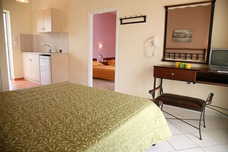 Deluxe family apartments.. The apartments are beautifully decorated with a big wrought iron double bed in the main room and with two single beds in the adjacent place. Pastel colours, small items and a beutiful balcony  http://www.maistrali-apartments.gr/el/Deluxe-Rooms-Ksenodocheio-Maistrali-Zakunthos-65.htm