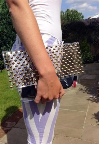 Gold studded transparent clutch bag
