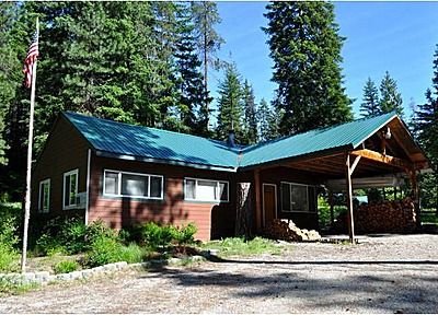 2-bedroom cabin perfect for your weekend getaways! 1.33 acres with access to snowmobile and dirt bike trails, only 5 minutes from Lake Wenatchee and Fish Lake. Spacious living area with a free-standing wood stove, river rock accent wall, cedar interior walls, new bathroom, new metal roof, and attached carport. Detached 528 sqft garage. Community river access to Chiwawa and Wenatchee Rivers - great for cooling off and floating the rivers in the summer months.  #lincolnlogcabin