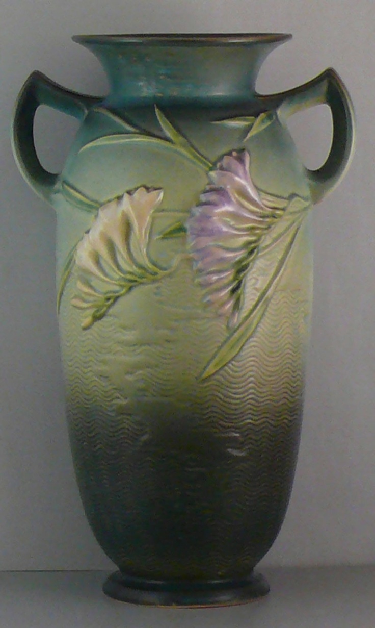 Vintage Antique Roseville Art Pottery Green Freesia. The shape of the vase and the handles are very nice.