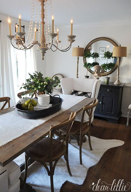 I love the height these lamps from HomeGoods add to the sideboard and the texture that the shades add to this simple black and white dining room. The wood tones throughout the room help add warmth to the space and balance out the elegance of the chandelier. (sponsored pin)