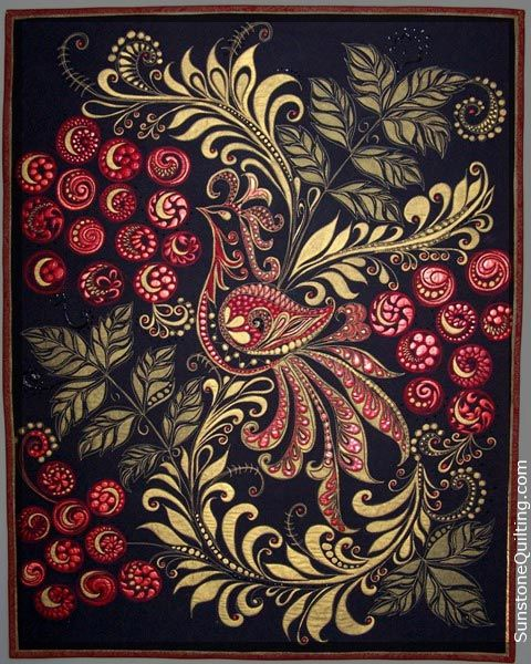 """Russian Fairytale (2010)  This quilt introduces a traditional Russian design, """"Khokhloma"""",which often incorporates vivid poetic imagery into large floral elements. It is quilted and painted in traditional colors of gold, black, red."""