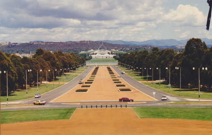 Anzac Parade is a short, broad boulevard named in honour of the soldiers of the Australian and New Zealand Army Corps (ANZAC). It stretches from near the north shore of Lake Burley Griffin to the foot of the Australian War Memorial. Parliament House and old Parliament House can be seen in the distance in this photo of Anzac Avenue from the War Memorial.