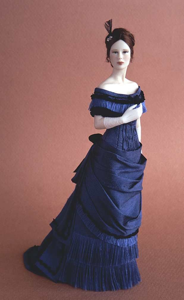 NAME: Agatha - PERIOD: 1877-1879.  Ball dress in blue douppion silk trimmed with ribbons, fringes and drapery.