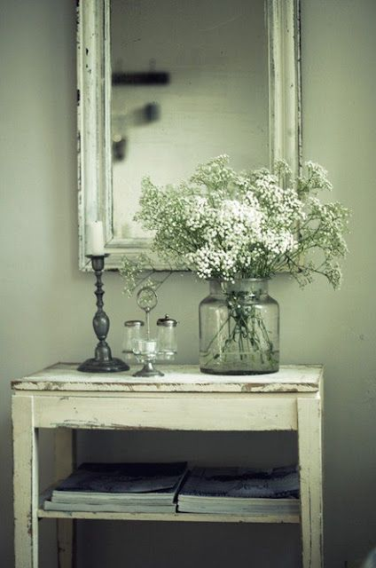 Small white country table vignette with mirror