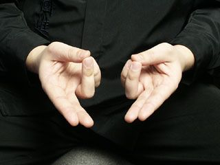 "Prana mudra (""Mudra of Life"") stimulates base Chakra, legs & feet. It elevates energy level, clears eyesight & enhances self trust. Straighten index & middle fingers; place thumb against ring & little fingers at the tips, forming a circle. Focus on base Chakra & soles of feet. 1 minute deep, slow, normal breathing, then Reverse Breathing for several cycles. Breathe in & tighten abs, sex organs, perineum & buttocks. Hold breath 5 seconds & release all except mudra. Repeat cycle for 5 minutes."