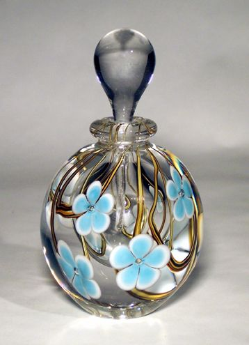 Love these glass perfume bottles.  Saw them in person at the Pittsburgh Arts Festival.  Would love to have one. http://www.gandelmanglass.com/floral-art-glass-perfume-bottles.html