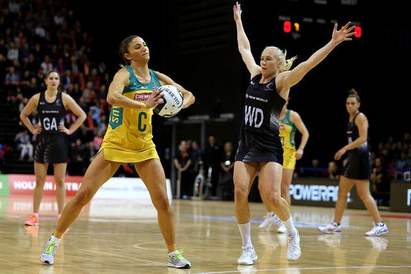 Kim Ravaillion (L) of Australia looks to pass the ball while defended by Laura Langman of New Zealand during the Constellation Cup International Test match between the New Zealand Sliver Ferns and the Australia Diamonds on October 20, 2016 in Invercargill, New Zealand.