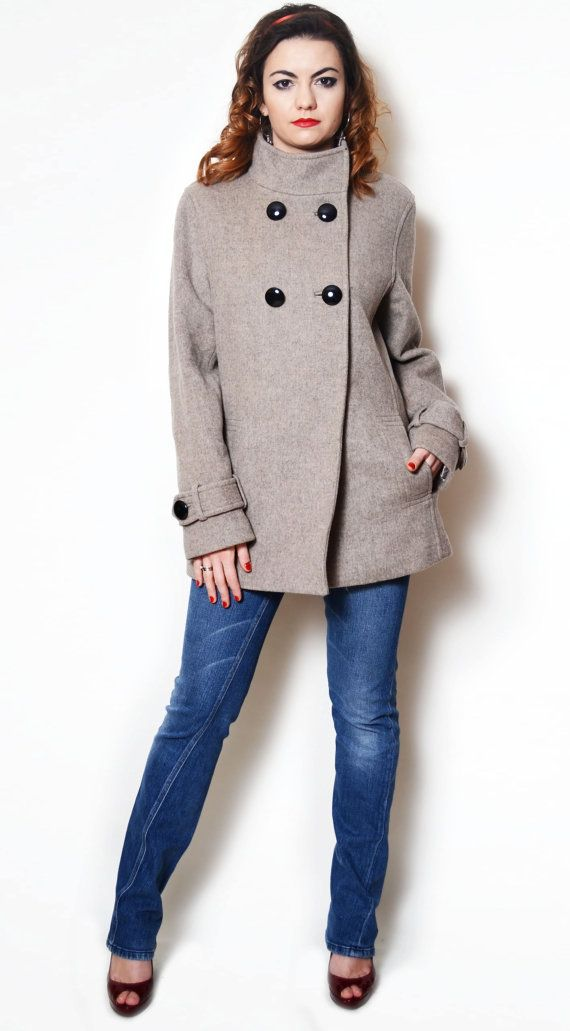 Vintage beige wool coat.  The model in the pictures is size S/36 and 165 cm height. Please check measurements with your own to avoid problems with the size. Make sure you double the measurements where shown (*2):  Label size: XL/42 Total lenght: 80 cm / 31.5 inches Sleeve lenght: 61.5 cm / 24.25 inches Shoulder to bottom: 69 cm / 27.25 inches Armpit to bottom: 48 cm / 19 inches Armpit to armpit: 56.5 cm *2 / 22.25 inches *2 Hips: 57 cm / 22.5 inches *2 ...