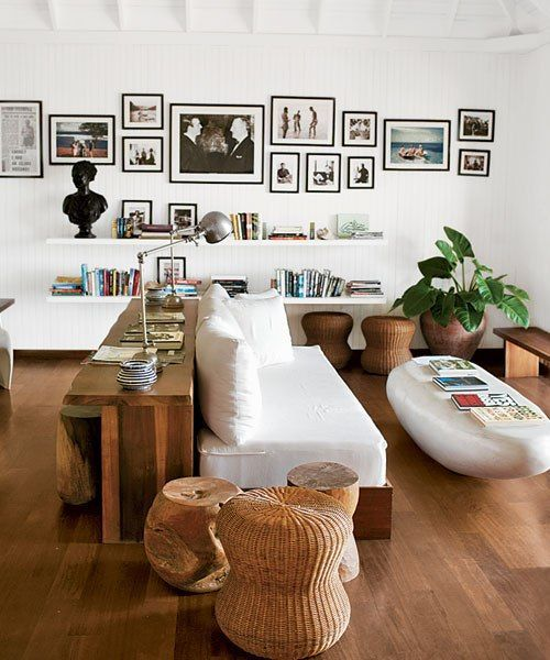 brown & white. wicker and wood. Love the bookshelf placement and the photo layout.