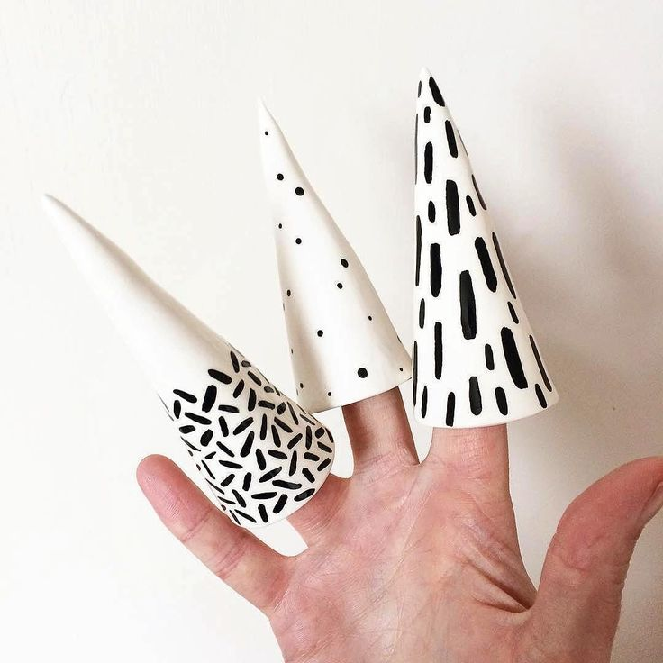 Cone party! @natko.ceramics doing her best Edward Scissorhands impression  Love these clever little cones made for storing rings. Nat hand paints all these detailed designs in the UK. . . . #regram #ceramics #ceramic #tableware #craft #handmade #ringcones #ring #interiorstyle #pottery #interiordesign #homewares #slowdesign #liveauthentic #handmadeceramics #pattern #britishceramics