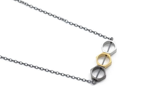 Oxidized sterling silver necklace, with hexagon shaped beads plated with matte silver, mattegold and oxidized brass.  Made in Oslo, Norway