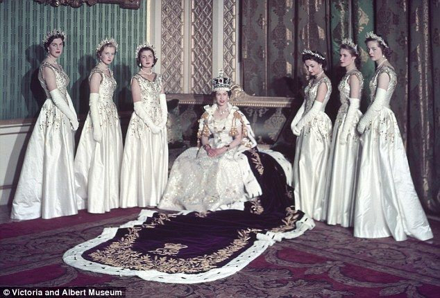 Britain's 27-year-old Queen Elizabeth had been crowned in Westminster Abbey earlier that day, June 2, 1953, and now she poses for photographs in Buckingham Palace. She is wearing the Imperial State Crown and the exquisite Coronation gown designed by Sir Norman Hartnell. The 21ft ermine-trimmed velvet Purple Robe of Estate flows from her shoulders.    She is flanked by her Maids of Honour: six of the country's most blueblooded young women, all single, beautiful and, like the Queen, wearing…