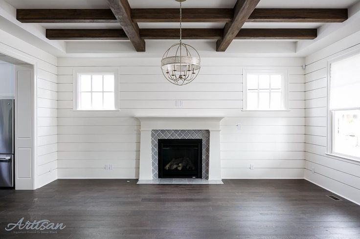 """Jason Black on Instagram: """"White Shiplap walls and aged wood beams give this living room a very comfortable feel. #ballarddesigns"""""""