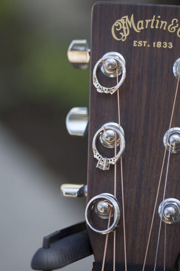 Wedding rings on guitar pegs