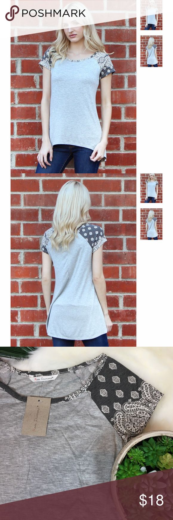 ✨NEW✨ Paisley Gray Printed Hi-Low Raglan Tee S-XL Gorgeous. BOHO Chic Paisley Sleeve Raglan Hi-Low Tee by Rose Diamond. Gray with Paisley print sleeves overlay ... absolutely BEAUTIFUL!!! This top is one of my favorites. Unlike other boutique items ... this gem is MADE IN THE USA!! Sizes S-XL. They are new with tags & from a smoke free home!! Size shown on mannequin is a small. Runs true to size. Rose Diamond Tops Tees - Short Sleeve
