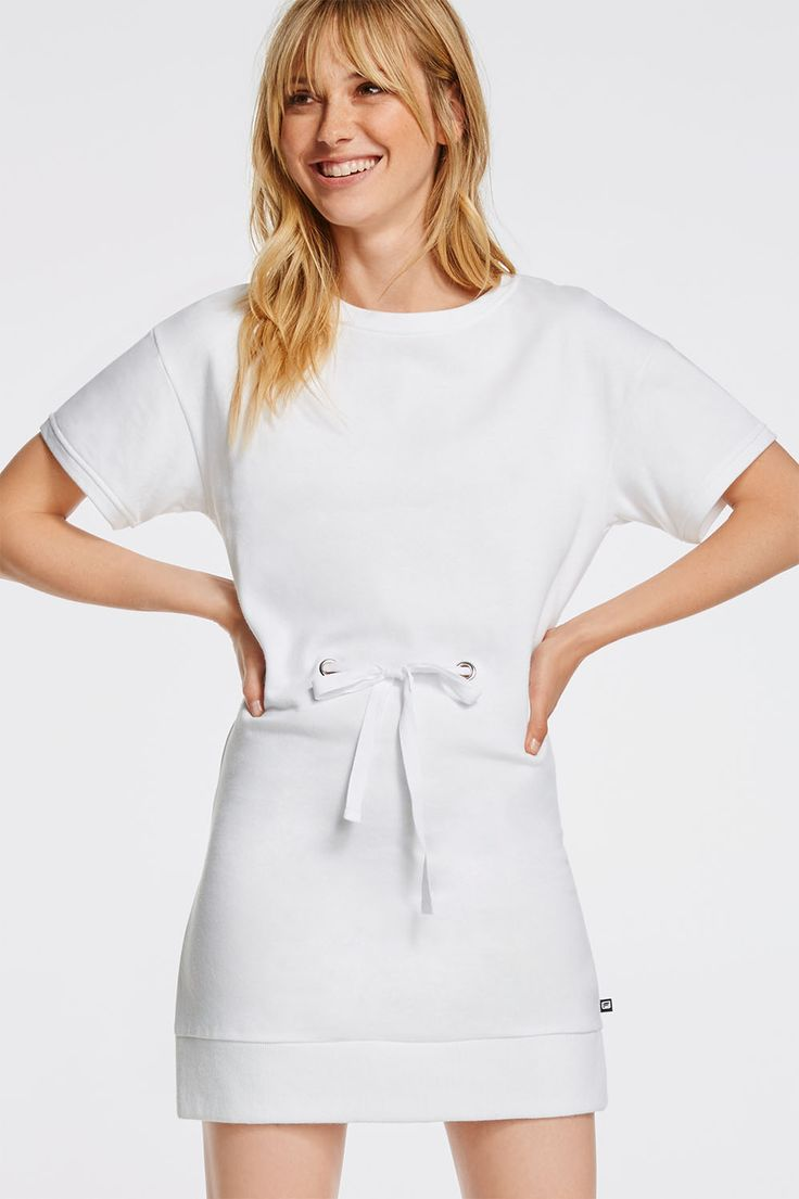 This French terry dress is made for the girl on the go. Its boxy silhouette is easy to move in and the eyelet detail at the waist shows off hints of skin while keeping you cool. | Odin Dress- Fabletics