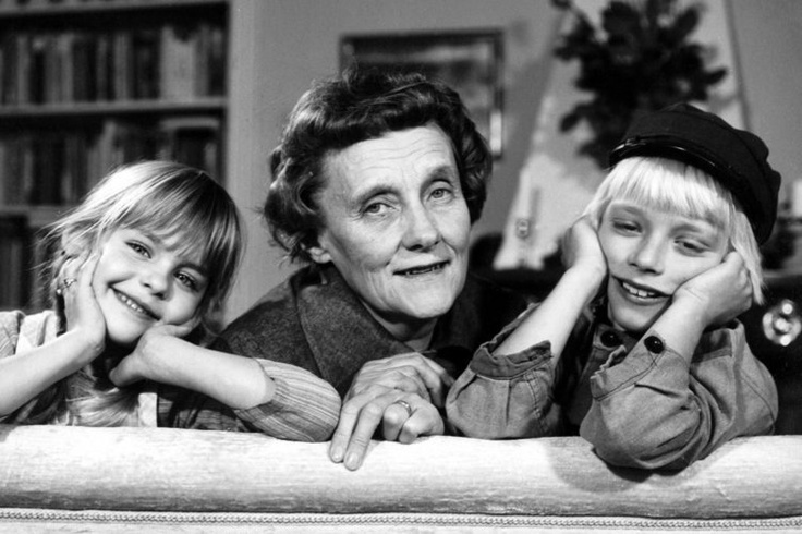 Astrid Lindgren, author and writer. Portrait with her 2 characters Emil fra Lønneberg and his sister Ida. Photo, black and white, history, dear childhood memories.