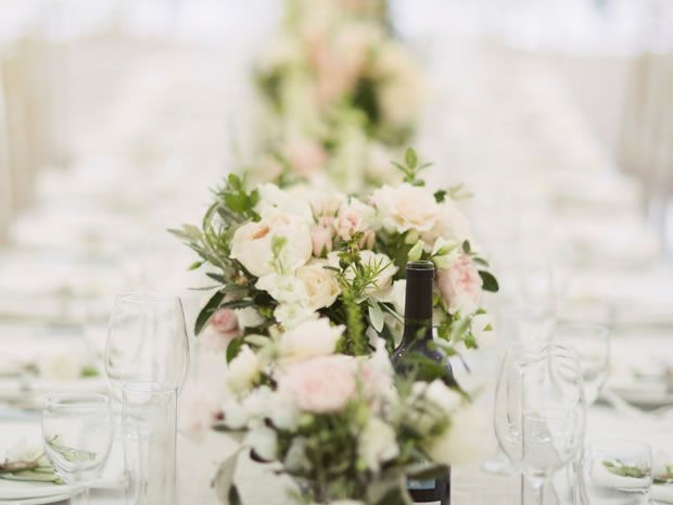 This #tablerunner by Fiona Perry is scented garden roses and herbs. Image © David Jenkins. #weddingflowers #weddingtables