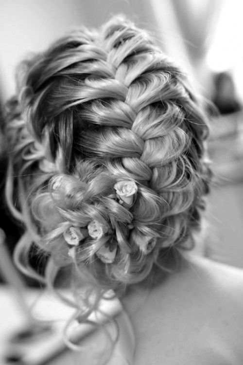 SECTION HAIR INTO 3 PIECES, LOOSELY FRENCH BRAID EACH AND WRAP ALL 3 INTO A BUN AT THE BASE.