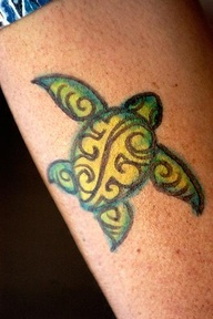I usually am not a big fan of colored tats but this one is cute and small!