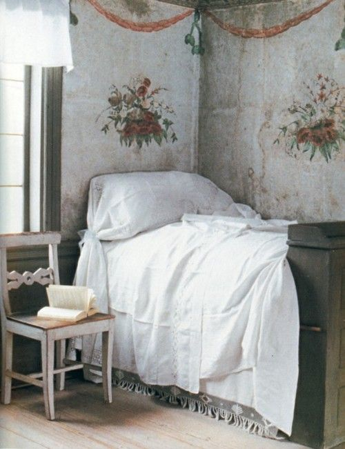 Relaxation in a small bedroom at one of the guesthouses- love the stencil on the curtain panels used to cover the walls