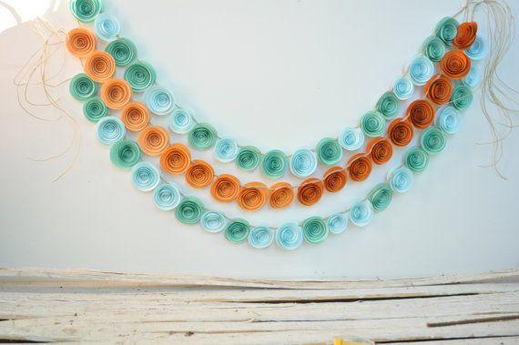 He encontrado este interesante anuncio de Etsy en https://www.etsy.com/es/listing/159708026/verde-azulado-y-naranja-boda-guirnalda