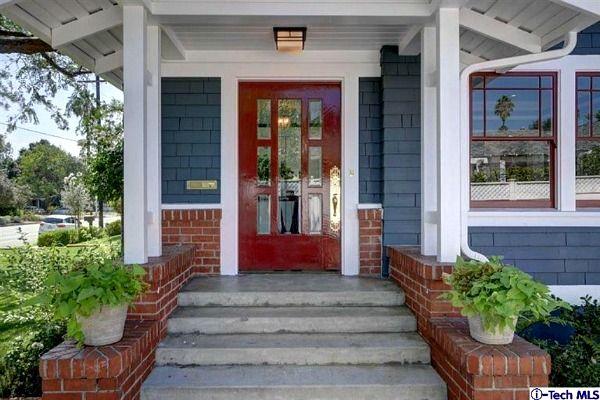 Red front door with blue siding on Craftsman in Pasadena | hookedonhouses.net