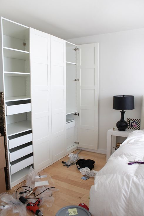 This IKEA closet system is called PAX wardrobe, the doors are white BERGSBO.