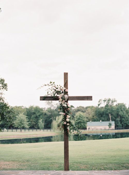 Wooden Cross With Flowers As Wedding Ceremony Backdrop