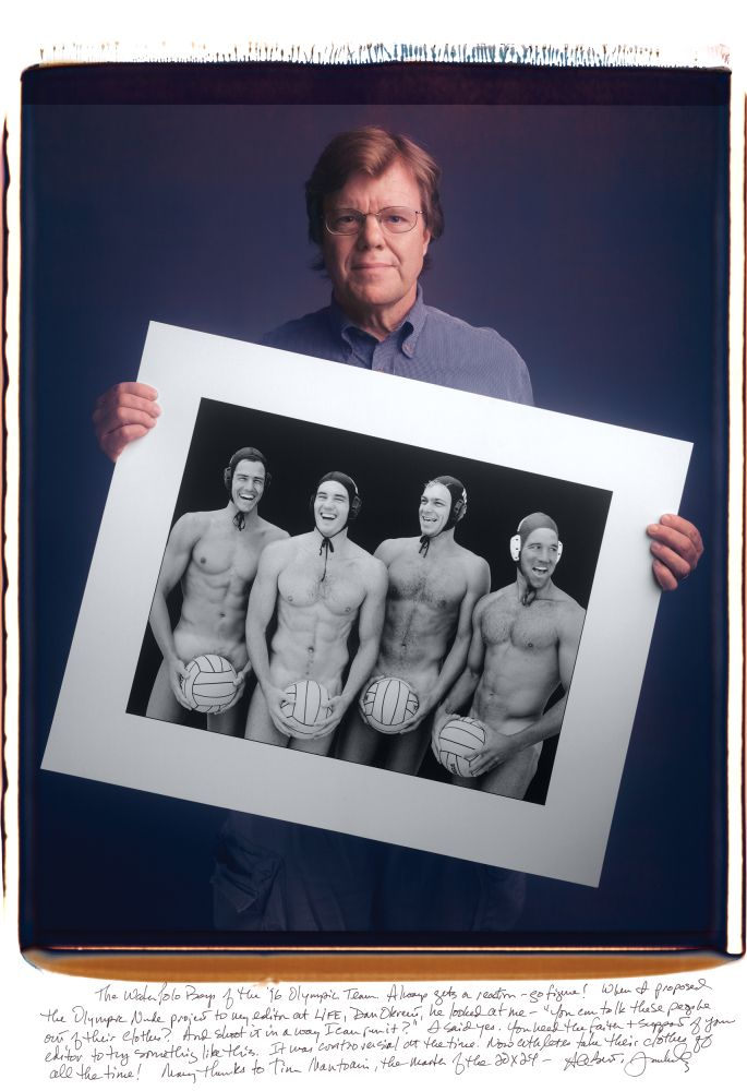 Joe McNally Posing with his commissioned shot for Life magazine of the 1996 U.S. Olympic water polo team, featuring Rick McNair, Alex Rousseau, Chris Humbert, and Chris Duplanty in the buff