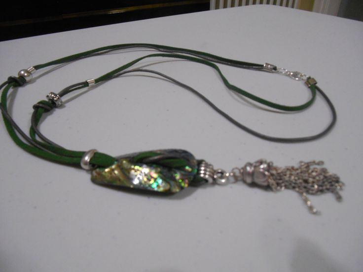 "A ""snake"" necklace from green amazing ivory, real leather and silver plated decoration."