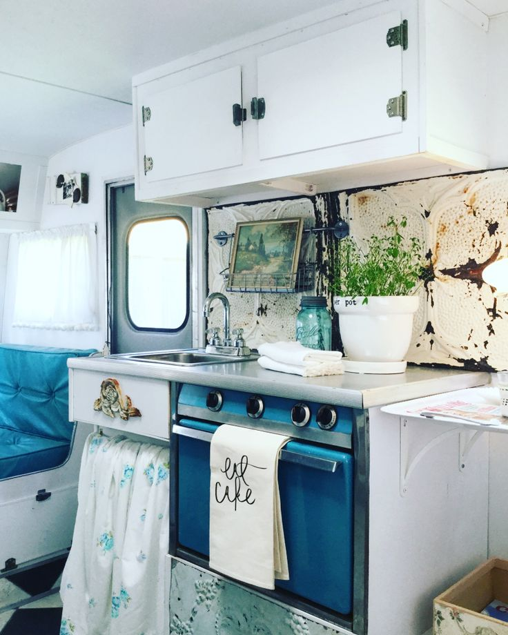 vintage camper dressed in blues