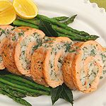 Stuffed with shrimp and scallops and napped with a delicate beurre blanc sauce, this salmon roll makes an elegant dish for holiday entertaining.