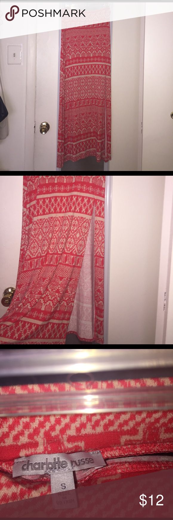 Tribal Maxi Skirt Long, coral tribal maxi skirt from Charlotte Russe! It has a super cute slit on the left side. Very soft, light and flowy material (-: brand new condition, I haven't worn it once. Charlotte Russe Skirts Maxi