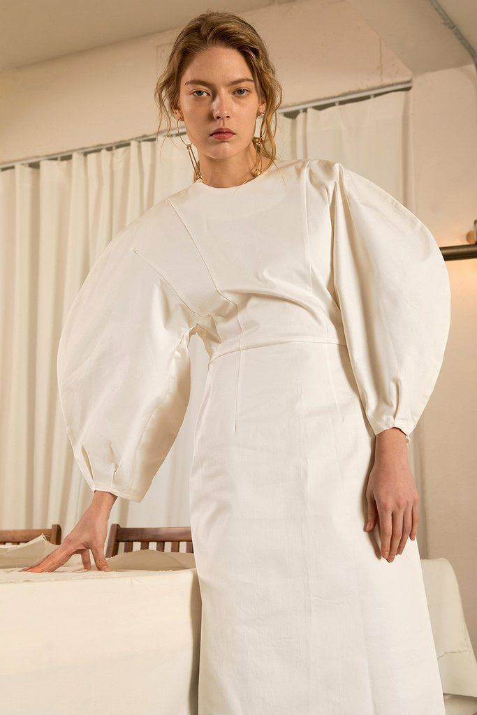 The Leyla dress in Off White, featuring round neckline, long puff sleeves with raglan detail at cuff, concealed zip fastening at the back. Fitted bodice.