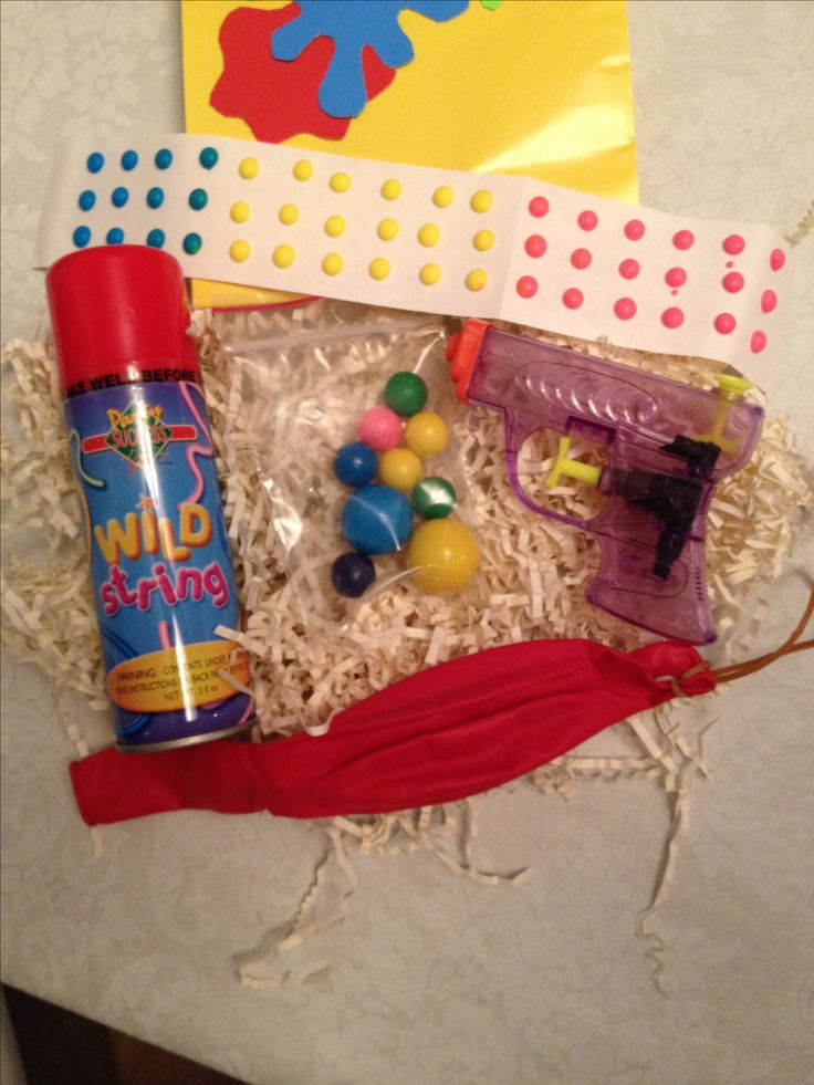 Contents of goodie bags for paintball party guest. Truthfully, all I needed was the silly string. The adults loved it as much as the kids! It was perfect because we were already outside.