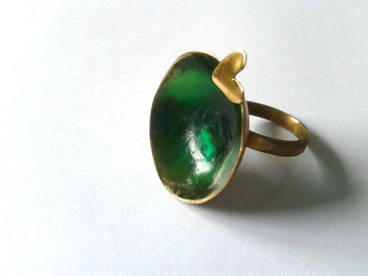 Handmade,statement one of a king bronze ring with green resin base https://www.etsy.com/listing/187672309/handmade-statement-one-of-a-kind-bronze