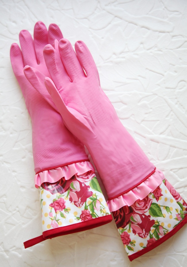 Spring Cleaning Rubber Gloves In Pink perfected with satin accents and rose printed oilcloth cuffs. Complete  with loops for hanging.One size fits most,  100% Rubber gloves,  100% EVA coated cotton cuffs,  Imported lol one size fits most