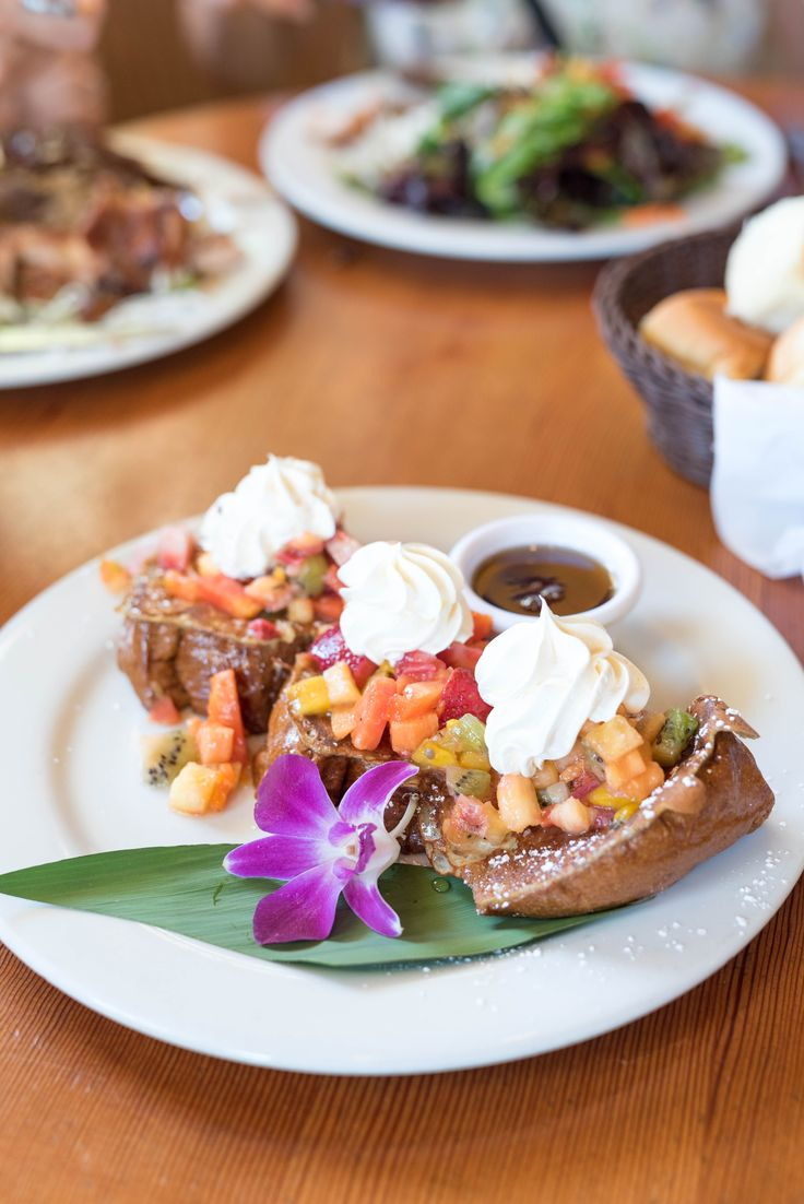 Hawaiian french toast made with sweet bread and topped with fresh tropical fruit~ find it at King's Hawaiian Bakery & Restaurant in Torrance, CA, and click to find even more hidden gems in this lovely SoCal city~  @visittorrance #DiscoverTorrance #california #travel #tips #ideas #restaurants #thingstodo #socal #hawaiian #food #tropical #best #french #toast #breakfast #diner #hawaii #ad