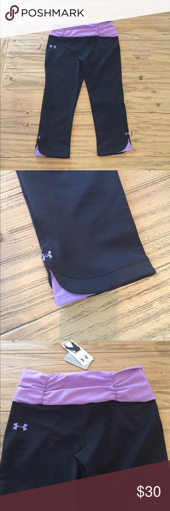NWT Under Armour M Capri compression leggings Brand new with tags size Medium ladies Under Armour compression Capri leggings. Black and purple. Super cute treatment at bottoms. Under Armour Pants