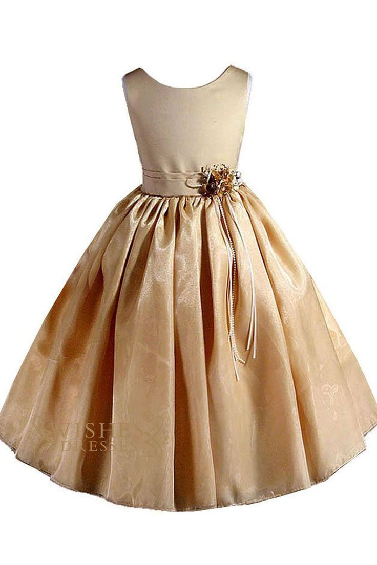 Organza dress with full skirt and ribbon sash and flower. Neckline:Round Length:Floor length Details:Flower.Sash Fabric:Organza,Satin Color:Gold Size:Any Size,Made from scratch. Please kindly refer to
