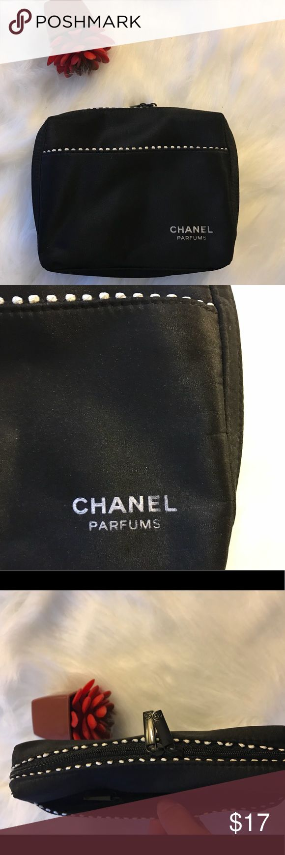 Chanel makeup bag Chanel make up bag. Has never been used, the letter are fading a little as you can see in pictures. The inside is clean. There's an extra zipper pocket in the outside. Chanel Bags Cosmetic Bags & Cases