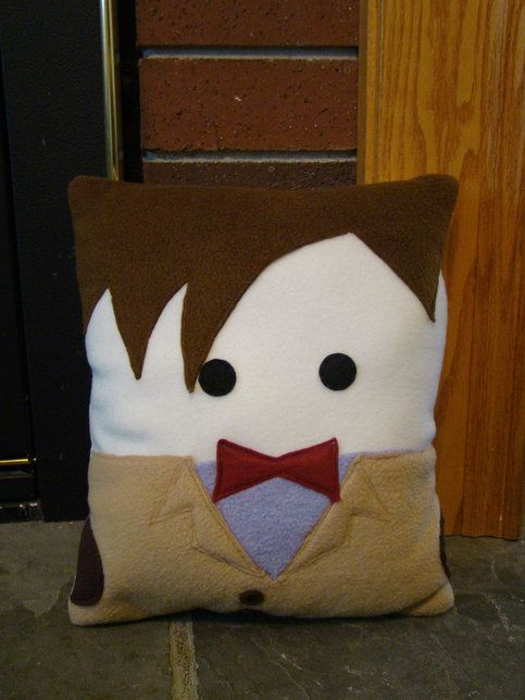 This pillow would be the perfect addition to any Dr. Who fan's room.  This is my original design. It gets copied over and over but this is the original.   Entirely hand made from top quality fabrics including anti pill fleece, allergen free fiber fill and eco friendly felt. All details are secu...