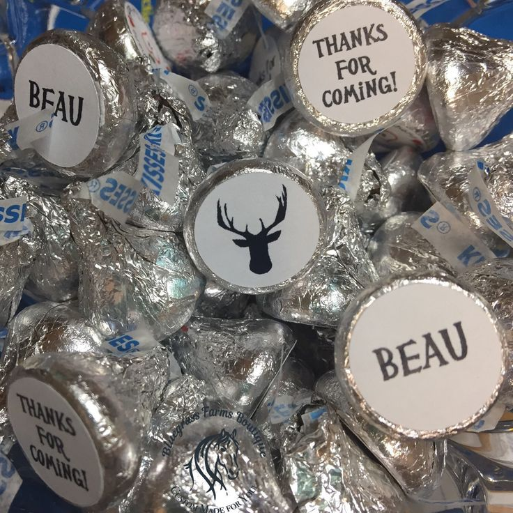Having a woodland themed baby shower?  Look at how these personalized stickers give life to these Hershey's chocolate kisses. Available with deer, hunting dogs and bears. They make cute favors, too!