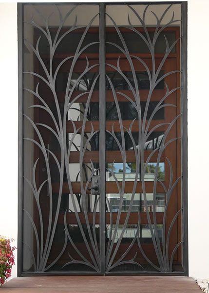 Wrought-iron grass design door