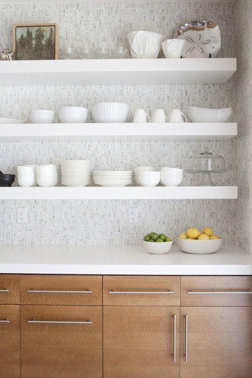 Beautiful kitchen cabinets with modern hardware, white quartz counter tops, chunky white modern floating shelves and mosaic tiles backsplash.