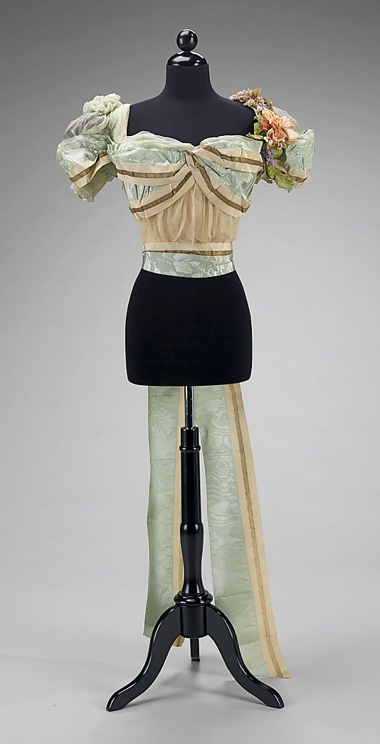 Silk evening bodice by Jean-Philippe Worth, French, spring/summer 1897. The use of ribbon as a major structural element in this bodice is inventive and effective. The elegant blue stamp on the petersham was used between 1897 and 1903 as a method of marking exports and assisting in combating piracy.