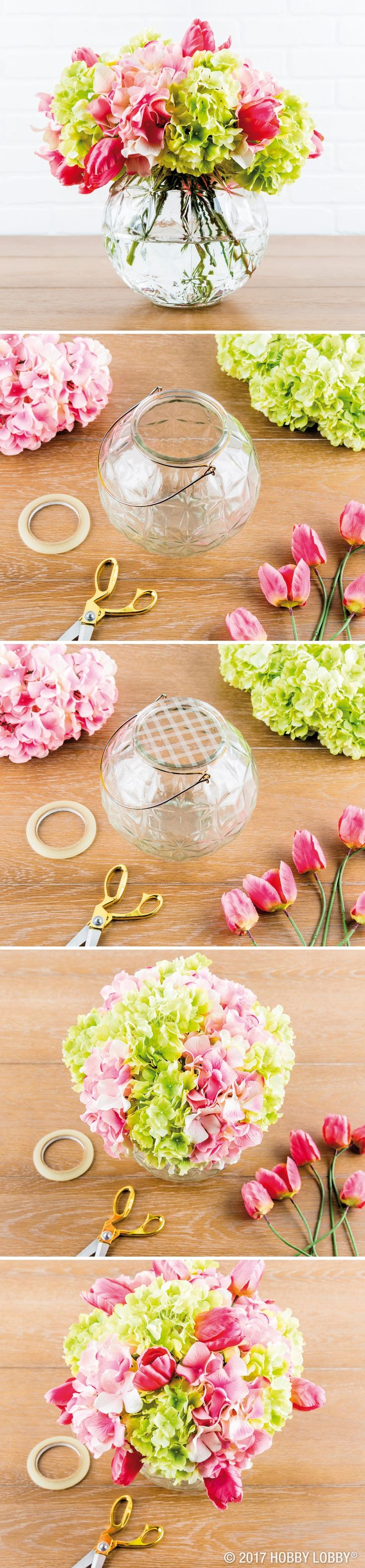 Bring life to your space with a DIY faux floral arrangement! First, trim stems as needed. Next, tape grid lines over the vase's opening—this will keep the stems in place. Starting with the largest blooms, arrange flowers in vase. Fill in any bare spots with smaller stems!