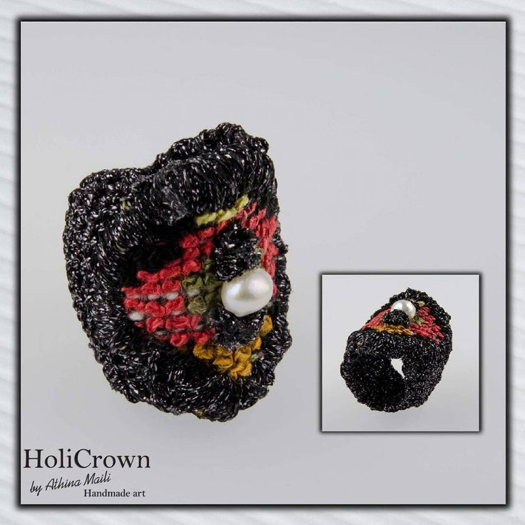 Hand knitted ring with embroidered detail and pearl.